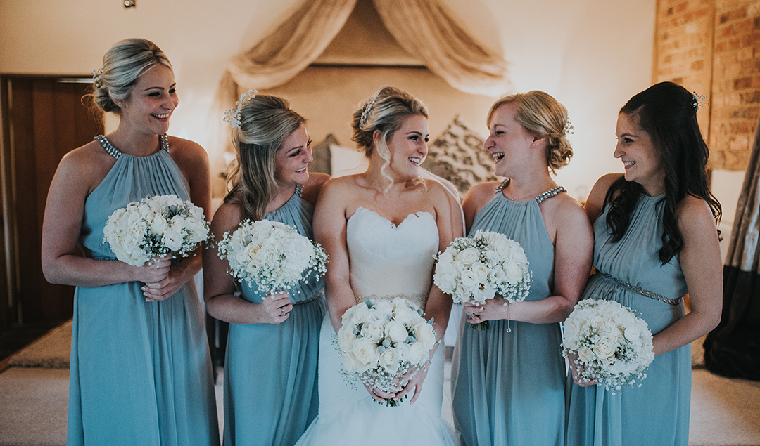 bd3ae0020a3 The blue bridesmaid dresses matched the Christmas wedding theme ...